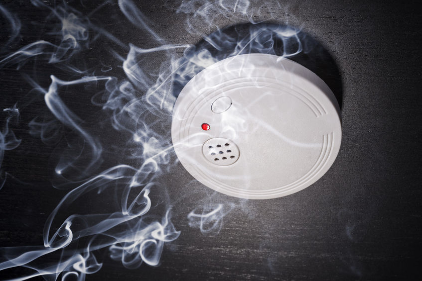 27738215 - smoke detector in the smoke of a fire