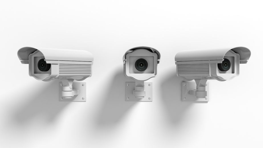 41045986 - three security surveillance cameras isolated on white background